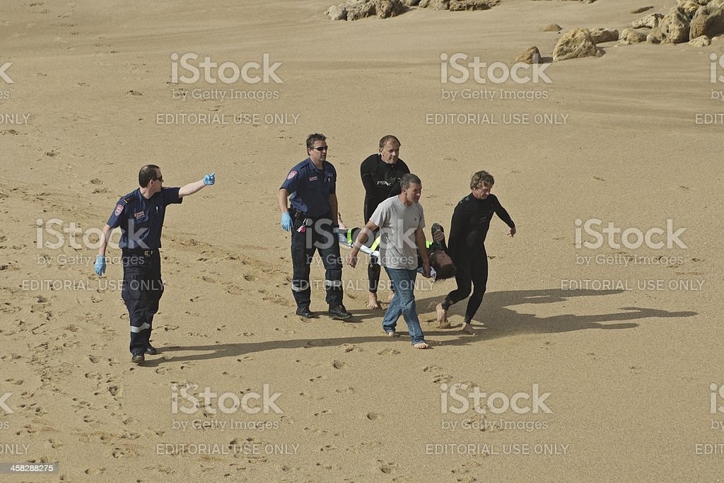 Injured surfer rescue stock photo