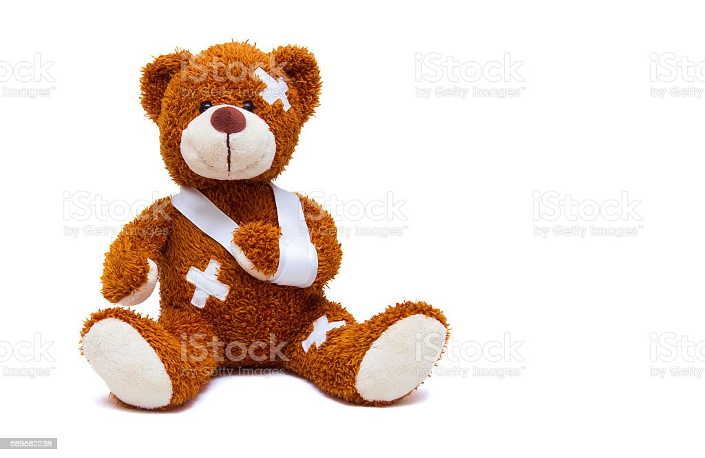 Injured teddy bear on white background stock photo