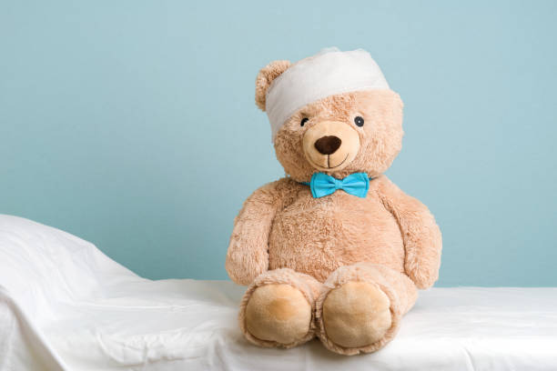 injured teddy bear - medical dressing stock pictures, royalty-free photos & images