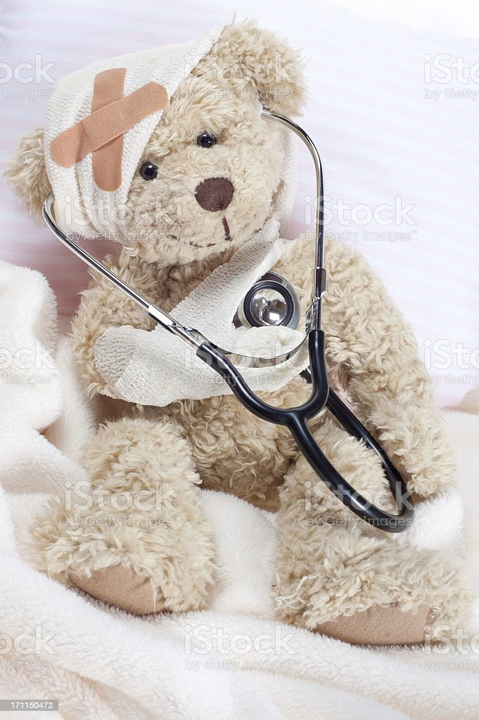 Injured Teddy Bear with Stethoscope royalty-free stock photo