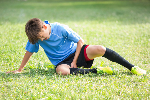 Injured teenage soccer player