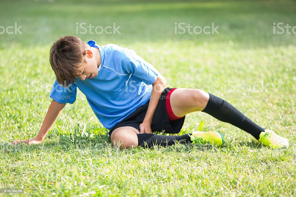 Injured teenage soccer player – Foto
