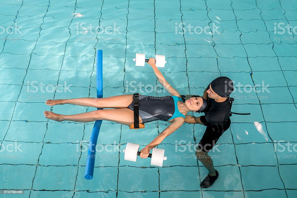 Injured woman doing hydrotherapy stock photo