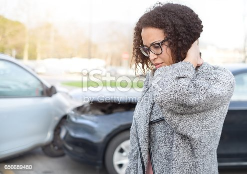 istock Injured woman feeling bad after having car crash 656689480