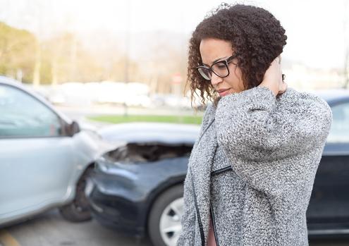 istock Injured woman feeling bad after having car crash 656689480