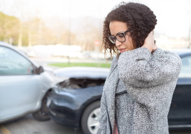 injured woman feeling bad after having car crash - car accident stock photos and pictures