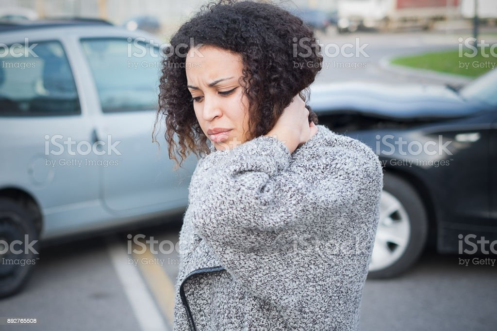 Injured woman feeling bad after having car crash stock photo