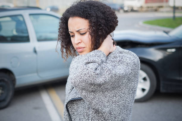 Injured woman feeling bad after having car crash Injured woman feeling bad after having a car crash misfortune stock pictures, royalty-free photos & images