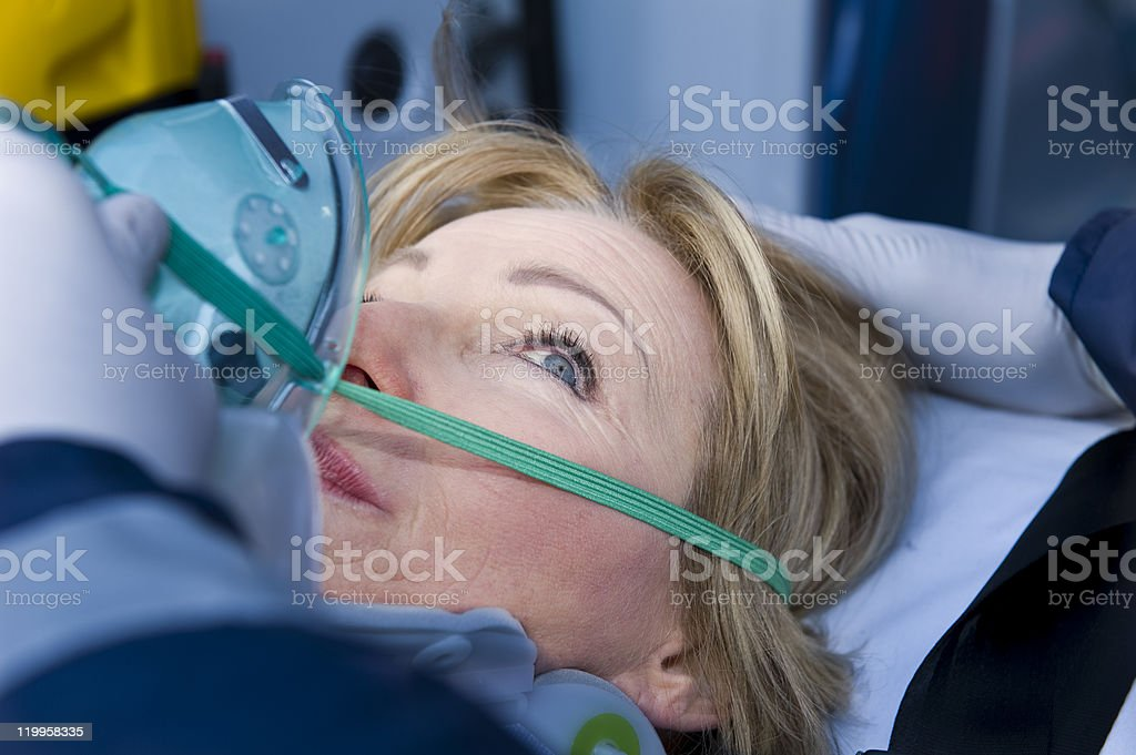 Injured Woman Receiving First Aid Assistance stock photo