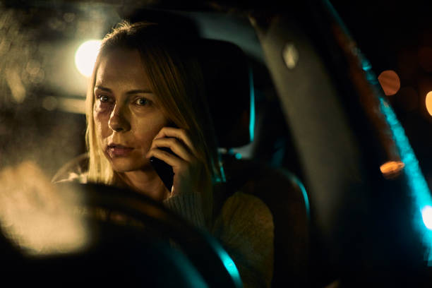 injured woman talking on the phone - impaired driving stock photos and pictures