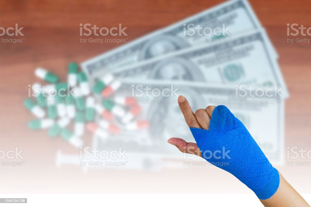 Injured Woman With Blue Elastic Bandage On Hand Isolated On One