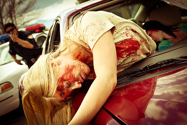 Injured Women in a Car after Accident with policeman responding stock photo
