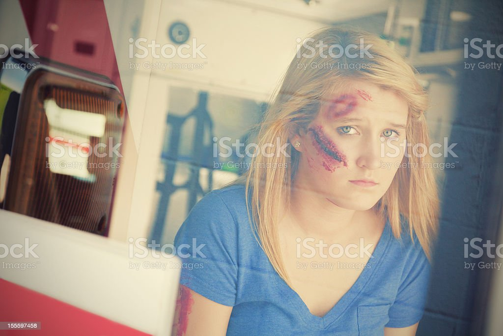 Injured young woman in ambulance royalty-free stock photo