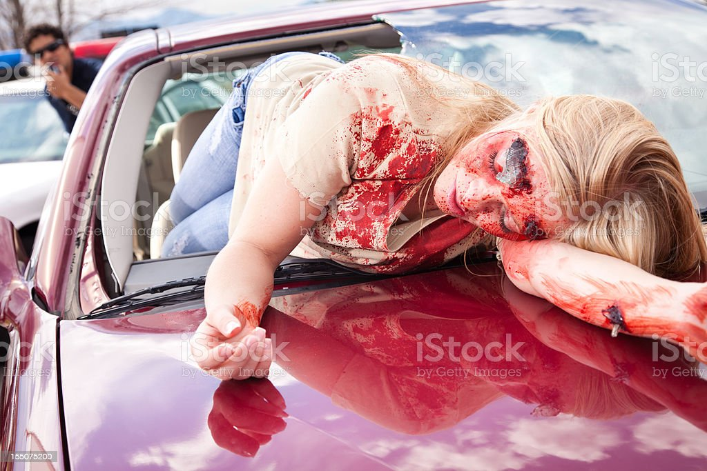 Injured Young Woman on Hood of Car from an Accident stock photo