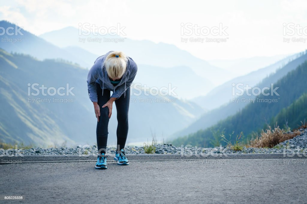 Injuries - sports running knee injury on woman. stock photo