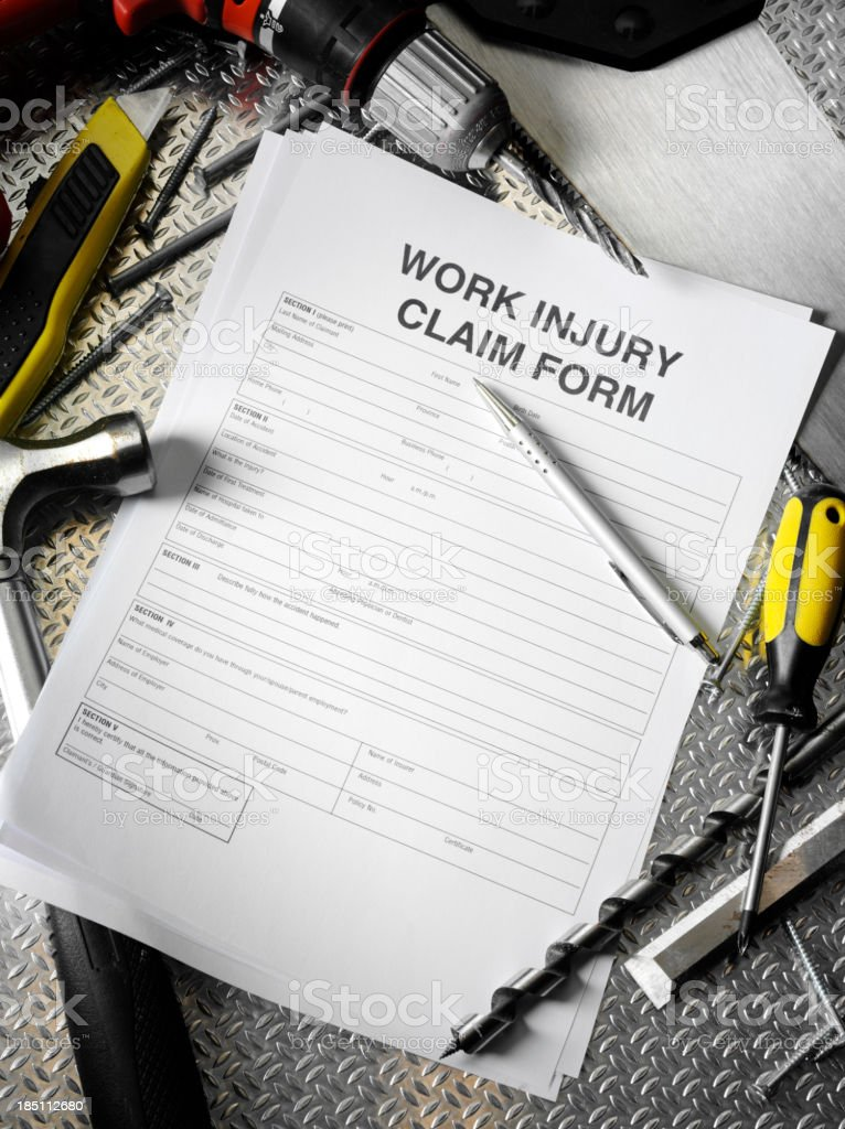 Injury Application with Work Tools royalty-free stock photo