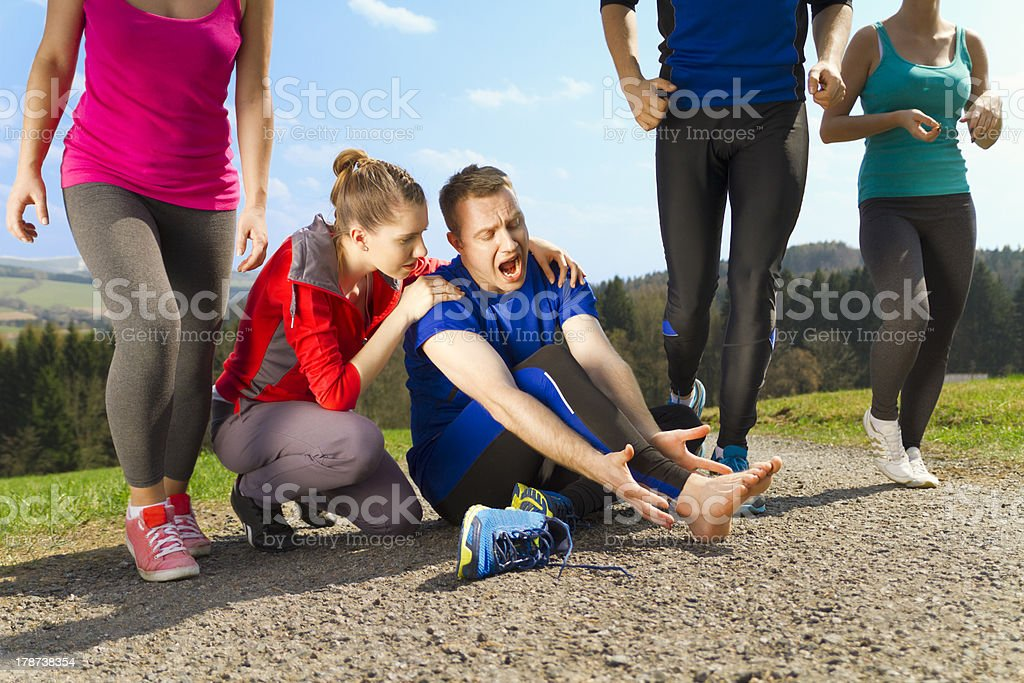 Injury during jogging stock photo