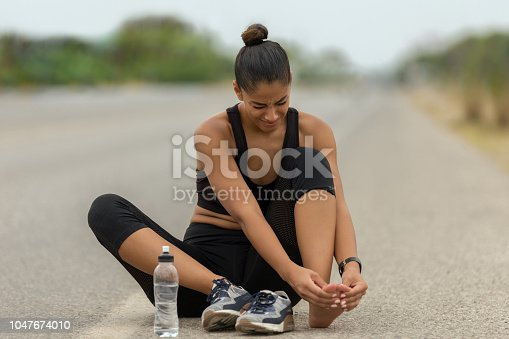 istock Injury her foot on road 1047674010