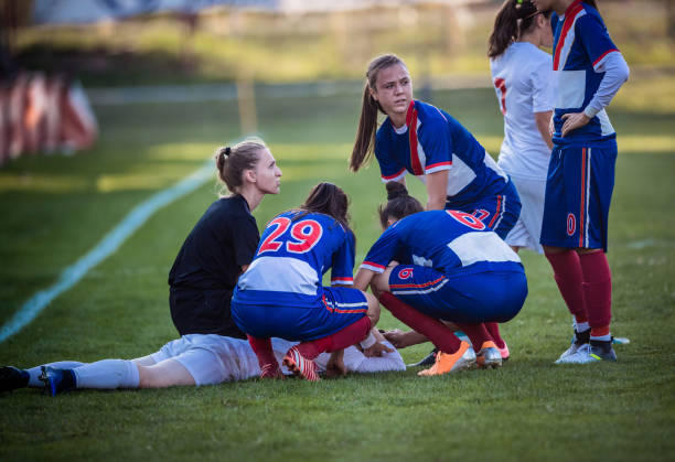 injury on women's soccer match! - soccer competition stock photos and pictures