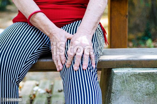 698466046istockphoto Injury pain in active senior woman knee 1184668683