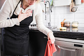 istock Injury while cleaning the house, kitchen and doing daily housework. 1198382875