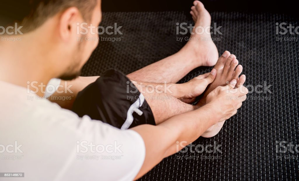 Injury while exercising and ankle pain stock photo