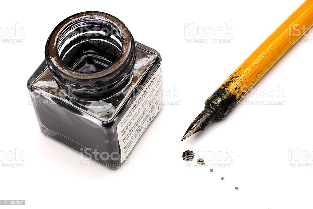 Ink bottle and nib pen stock photo