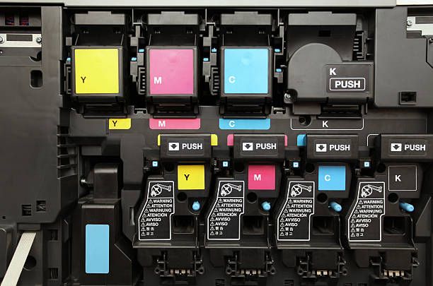 CMYK ink cartridges for laser copier machine close-up shot of a CMYK ink cartridges for laser copier machine cmyk stock pictures, royalty-free photos & images