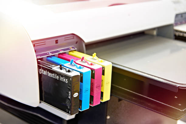 Ink cartridges in printer for textile stock photo