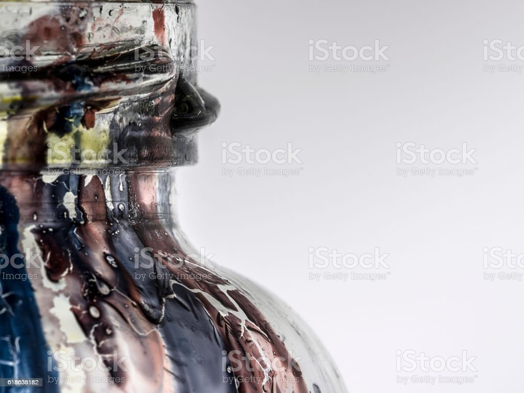 ink drips on a glass jar stock photo