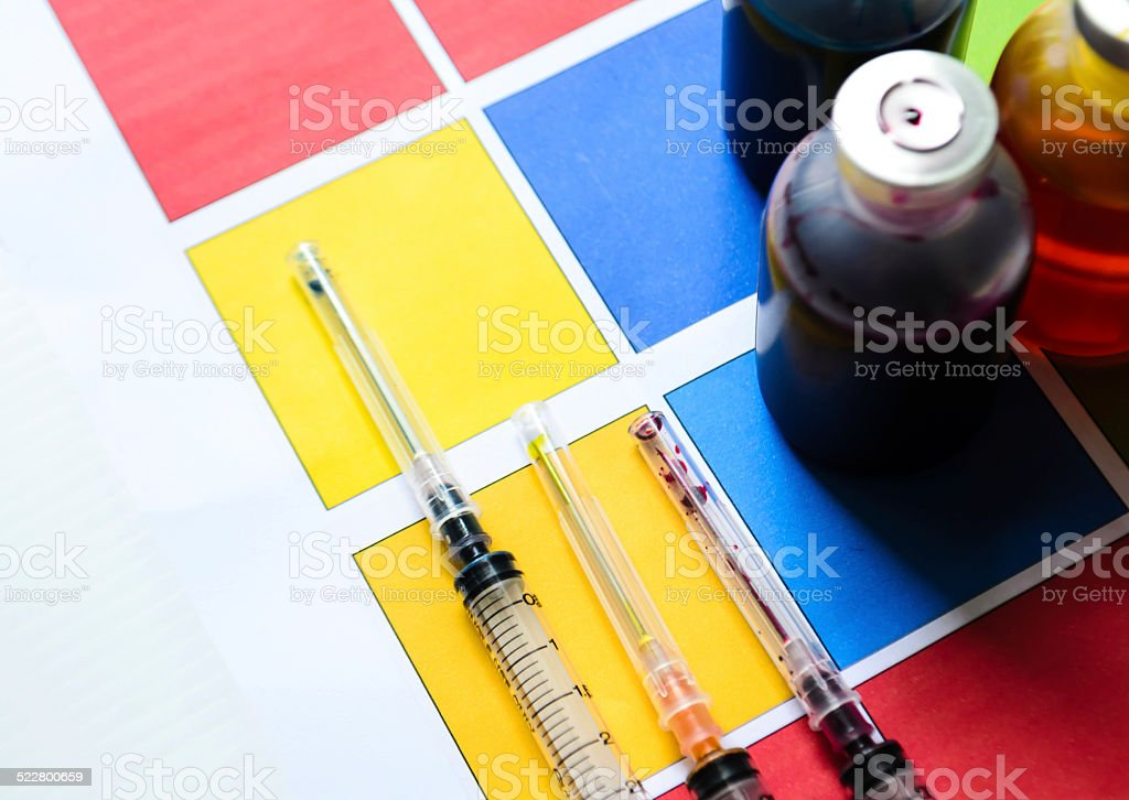 Bottle of ink printer has three colors. Colors is red, yellow and...