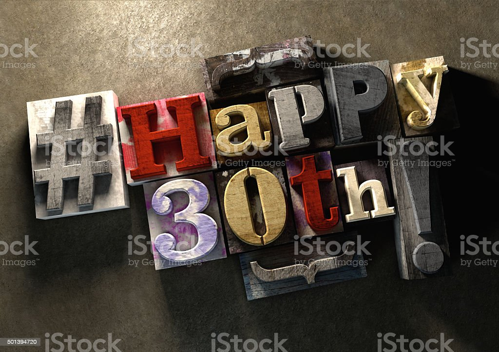 Ink splattered wood blocks with grungy Happy 30th birthday celebration stock photo