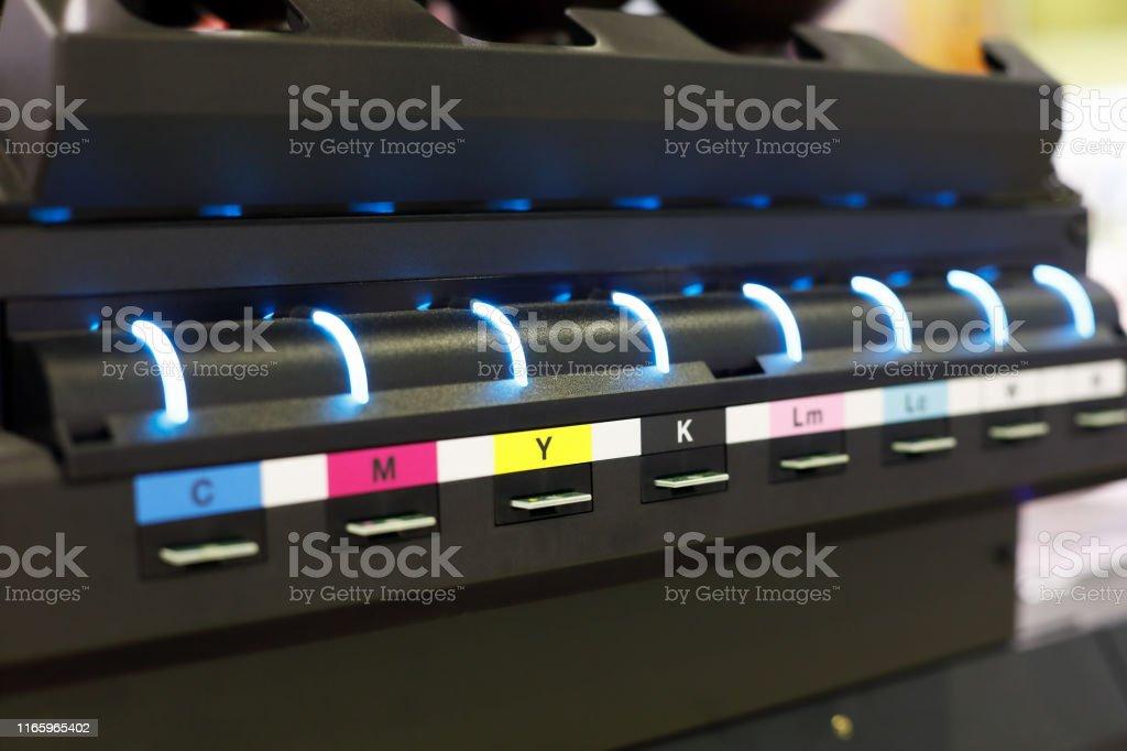 Ink supply unit of large format flatbed inkjet printer. Selective...