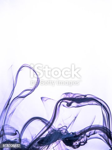 istock Ink swirl in a water on color background. The paint splash in the water. Soft dissemination a droplets of colored ink in water close-up. Abstract background. Explosion of color splashes acrylic ink 818208832