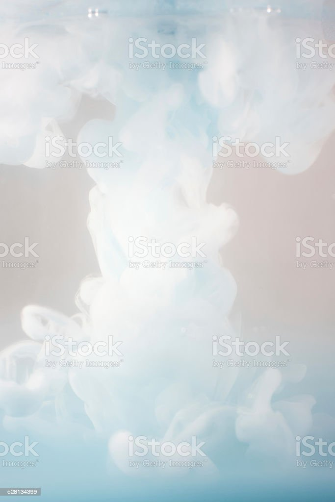 Ink swirling in water, cloud of ink in water stock photo