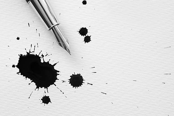 Inkblots and pen stock photo