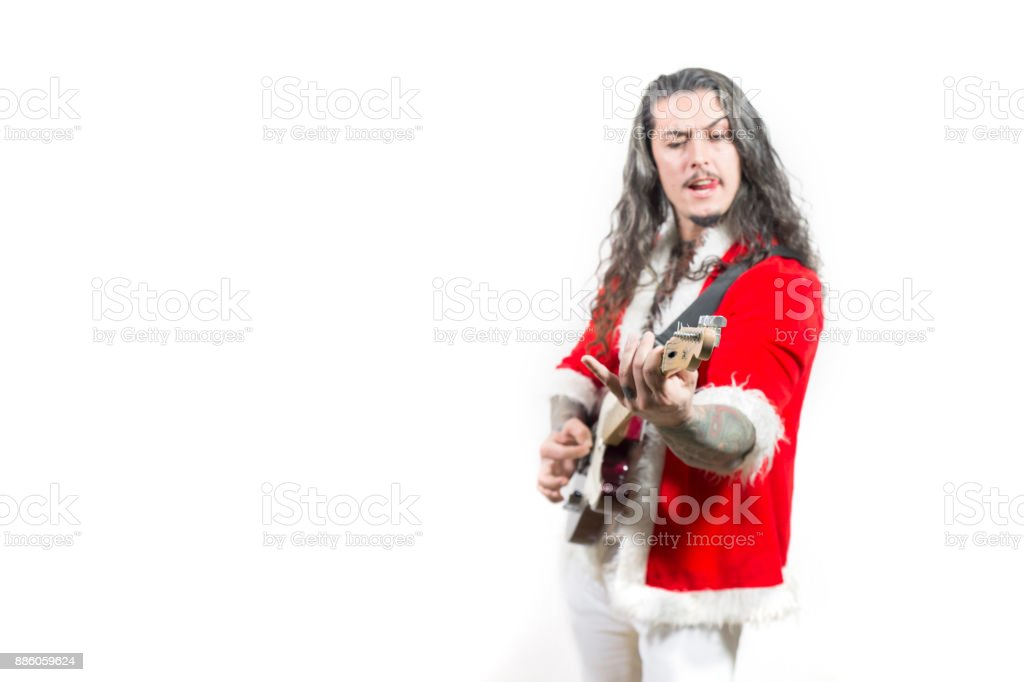 Inked Young Santa Claus playing guitar on white background stock photo