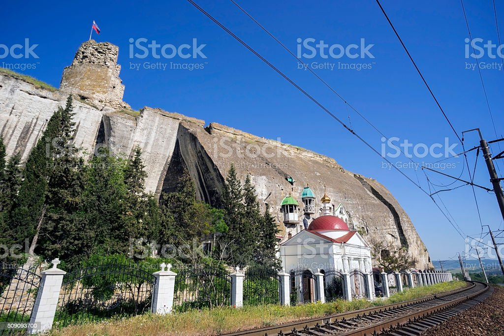 Inkerman St. Clement cave monastery in a cliff. stock photo