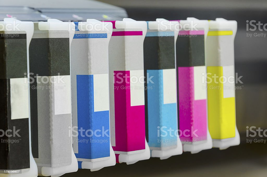 inkjet printer cartridges in a row stock photo