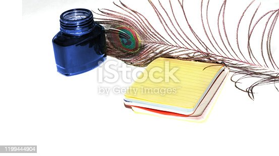 Inkwell on white background with diary, Writing concept.
