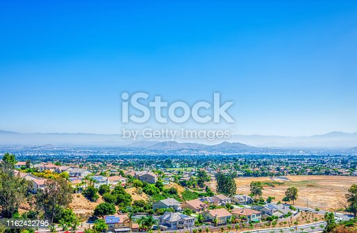 Southern California inland empire on a hot summer day with haze in the sky and room for copy text.