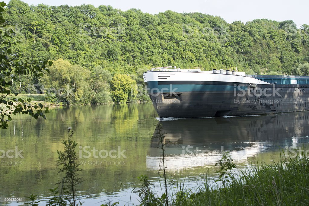inland shipping on a river stock photo