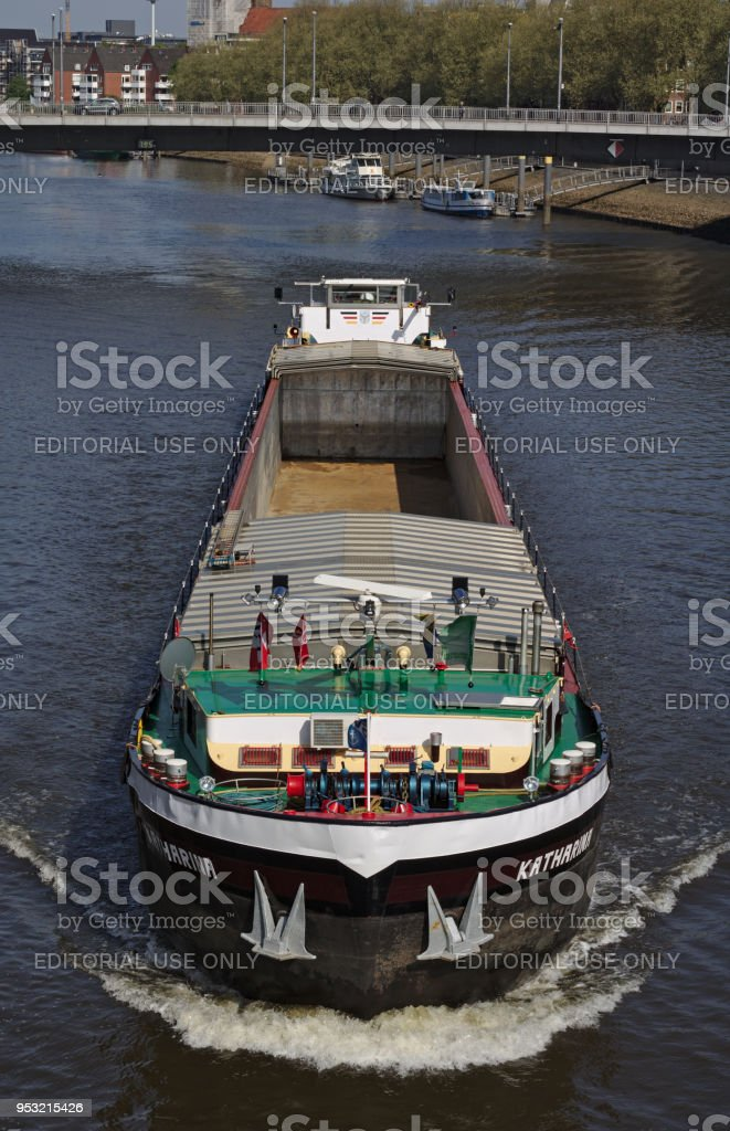 Inland vessel on the river Weser heading directly towards the viewer stock photo