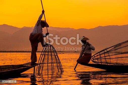 Fishermen sihouettes at Inle lake on sunset, Myanmar