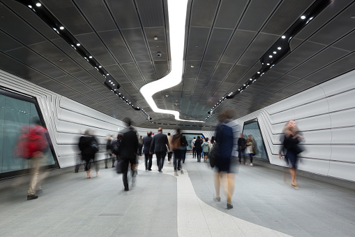 Inner City Business Workers walking through a futuristic tunnel