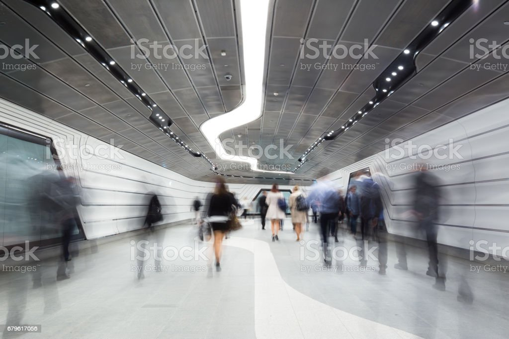 Inner City Business Workers walking through a futuristic tunnel stock photo