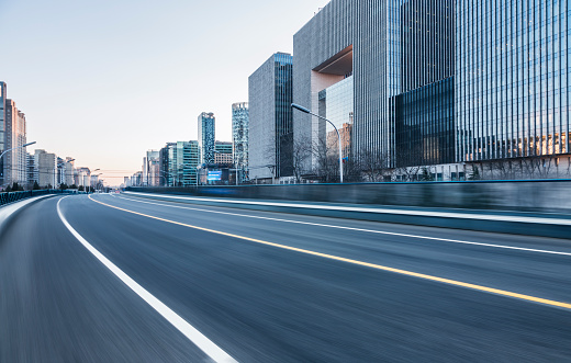 empty urban road with city skyline on background,Beijing,China,Asia.