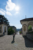 Lucerne/Switzerland - August 21 2015: Churchgoer inside the inner courtyard of Hof church (Hofkirche) in Lucerne, Switzerland