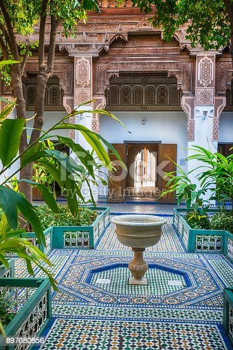 Oriental artwork and ornate decoration in the inner court of Bahia palace (open to the public) in the Medina of Marrakech, Morocco.