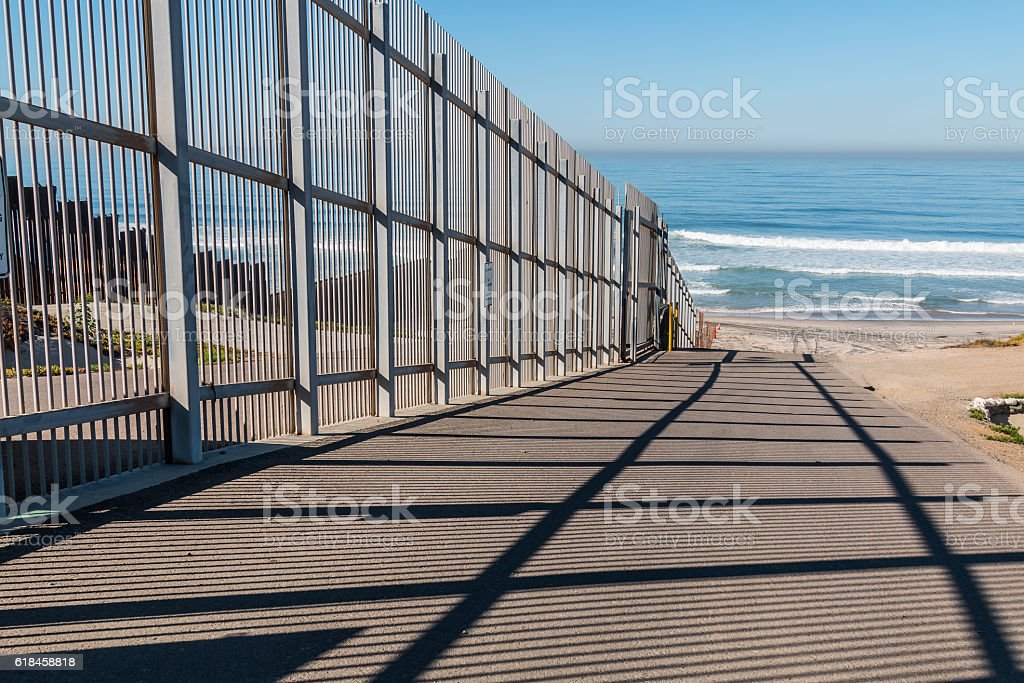 Inner fence of the international border wall which extends out into...